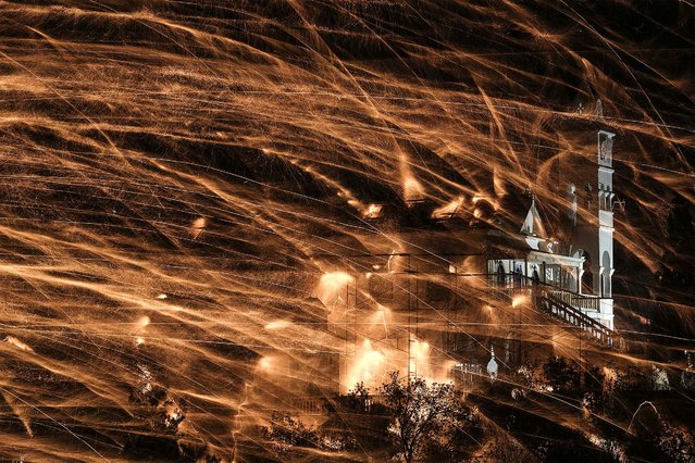 Hamndmade firework rockets target Panagia Erithiani church during Greek Orthodox Easter celebrations on the eastern Aegean island of Chios, Greece, late Saturday, April 11, 2015. Thousands of handmade rockets are fired every year on Great Saturday night, before the Resurrection, by locals of the two rival churches of Agios Markos and Panagia Erithiani, in the village of Vrontados. (Photo by Petros Giannakouris/AP Photo)