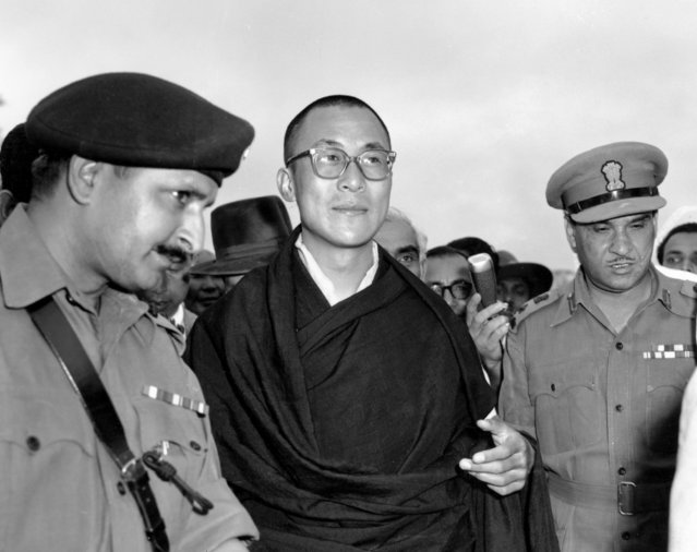 In this April 18, 1959, file photo, Tibetan spiritual leader the Dalai Lama, center,  arrives at Tezpur, Assam in India. Tibetan activists put up posters and hoisted a Tibetan flag in India's capital New Delhi on Sunday, March 10, 2019, to mark the 60th anniversary of 1959 uprising against Chinese rule. (Photo by AP Photo/File)