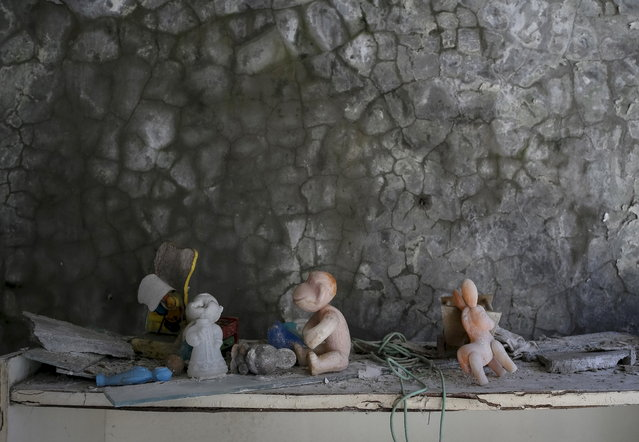 Toys are left in a kindergarten in the abandoned city of Pripyat near the Chernobyl nuclear power plant in Ukraine on March 28, 2016. (Photo by Gleb Garanich/Reuters)