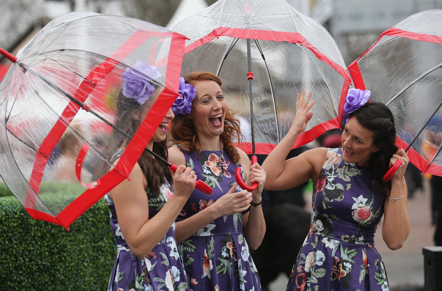 Racegoers enjoy the atmosphere of Ladies Day, the second day of the Aintree Grand National Festival meeting, on April 8, 2016 in Aintree, England. (Photo by Christopher Furlong/Getty Images)