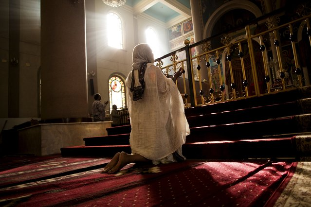 A Christian Orthodox woman prays at Medhane Alem Cathedral in Addis Ababa, Ethiopia, May 18, 2015. (Photo by Siegfried Modola/Reuters)