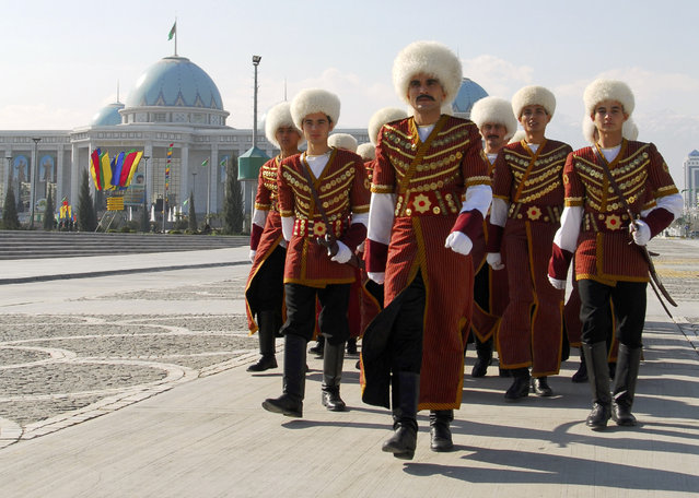 Soldiers in traditional costume march away from the Rukhiyet hall where Turkmenistan's new leader was sworn in in Ashgabat February 14, 2007. (Photo by Michael Steen/Reuters)