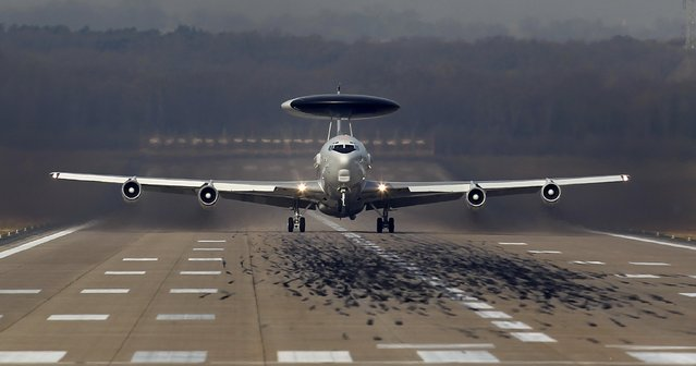 A NATO AWACS (Airborne Warning and Control Systems) aircraft takes-off for a flight to Poland from the AWACS air base in Geilenkirchen near the German-Dutch border April 2, 2014. The NATO alliance said it will start reconnaissance flights with AWACS planes from their home base in Geilenkirchen and Waddington in Britain over Poland and Romania to monitor the situation in neighbouring Ukraine where Russian forces have taken control of Crimea. (Photo by Ina Fassbender/Reuters)