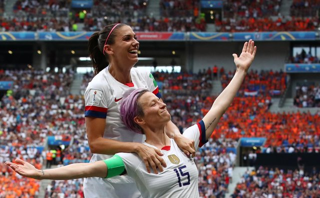 United States' Megan Rapinoe, right, celebrates after scoring the opening goal from the penalty spot during the Women's World Cup final soccer match between US and The Netherlands at the Stade de Lyon in Decines, outside Lyon, France, Sunday, July 7, 2019. (Photo by Denis Balibouse/Reuters)