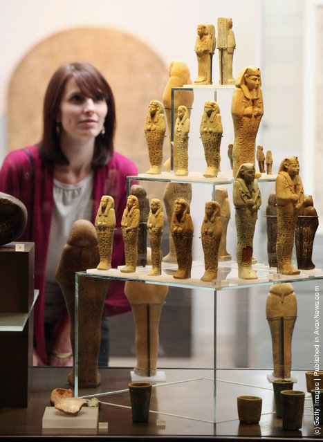 Laura Berry views mummiform figurines on display in the Ashmolean Museum's new exhibition of artifacts from ancient Egypt and Nubia