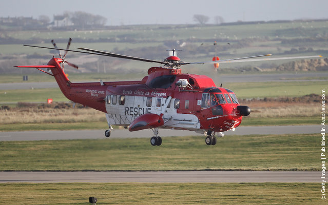 An Irish Coastguard Rescue helicopter leaves RAF Valley as the search continues for the crew of cargo vessel The Swanland which sank off north Wales on November 27, 2011 in Anglesey, Wales