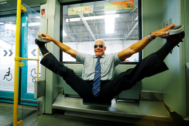 "Bodybuilding tram driver Peter Wirth, alias ""Bahnbabo"" practices gymnastics in a tram in Frankfurt, Germany, August 1, 2019. (Photo by Ralph Orlowski/Reuters)"