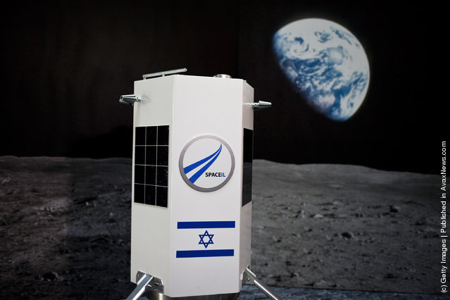 A prototype of a new nano spaceship is displayed during a press conference held by Israel's Space IL organisation