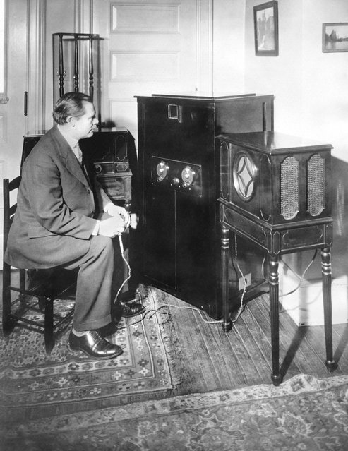 Dr E. F. Alexanderson of GE and RCA and inventor of the radio television process where a listener can see as well as listen to the broadcast, operating his 3 inch screen home television set, Schenectady, New York, January 14, 1928. (Photo by Underwood Archives/Getty Images)