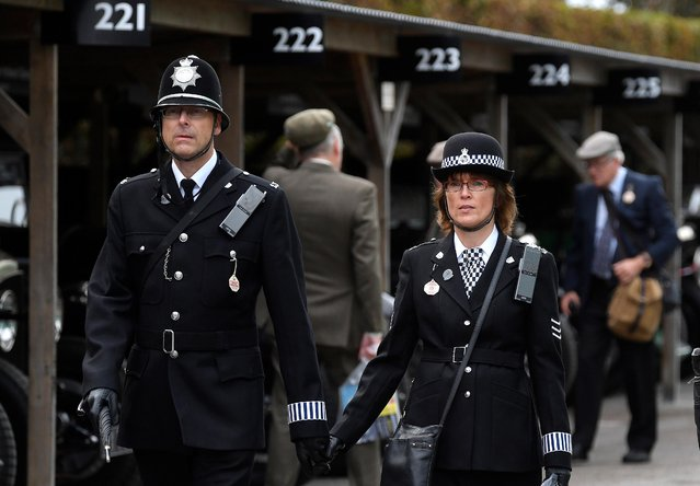 Motoring enthusiasts dressed as police officers attend the Goodwood Revival, a three day classic car racing festival celebrating the mid-twentieth century heyday of the sport, at Goodwood in southern Britain, September 13, 2019. (Photo by Toby Melville/Reuters)