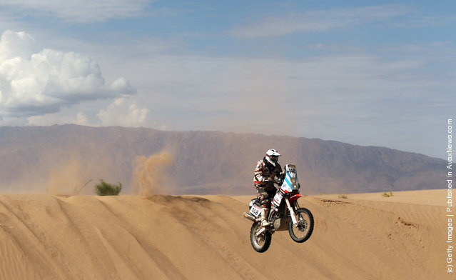 Mauricio Javier Gomez of Argentina and the Paco Gomez Team jumps off a sand dune during stage five of the 2012 Dakar Rally
