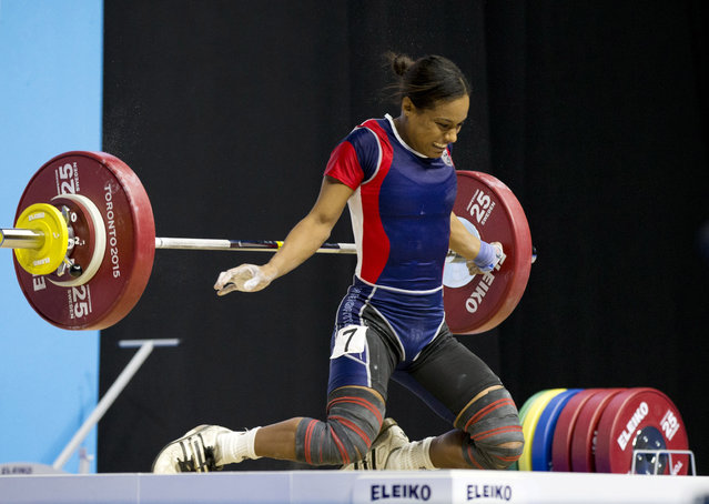 Pan Am record holder Yuderquis Contreras falls to her knees during a failed snatch attempt in the women's 53kg weightlifting event at the Pan Am Games in Oshawa, Ontario, Sunday, July 12, 2015. (Photo by Rebecca Blackwell/AP Photo)