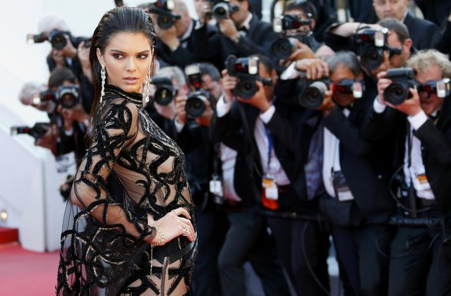 "Model Kendall Jenner poses on the red carpet as she arrives for the screening of the film ""Mal de pierres"" (From the Land of the Moon) in competition at the 69th Cannes Film Festival in Cannes, France, May 15, 2016. (Photo by Yves Herman/Reuters)"