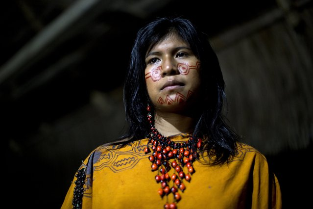In this June 23, 2015 photo, Yeni Casiano Barboza, 15, from the Ashaninka Indian community, Natividad, poses for a photo while waiting to compete in the annual beauty contest, in the Otari Nativo village, Pichari, Peru. For Ashaninka men, a woman's beauty is determined in part by her hair, her sense of humor, and whether she can cook a tasty cassava dish, according to some community members. (Photo by Rodrigo Abd/AP Photo)