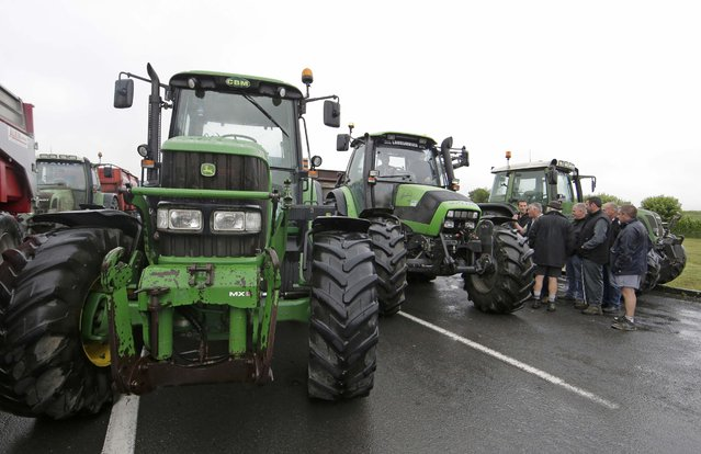Livestock breeders block access roads to the Mont Saint-Michel in the northwestern region of Normandy to protest against a squeeze in margins by retailers and food processors, July 21, 2015. The French President has said he would unveil an emergency package of measures to help France's livestock and dairy sector on Wednesday. (Photo by Jacky Naegelen/Reuters)