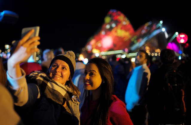 Women take a selfie in front of the Sydney Opera House during the opening night of the annual Vivid Sydney light festival in Sydney, Australia May 27, 2016. (Photo by Jason Reed/Reuters)