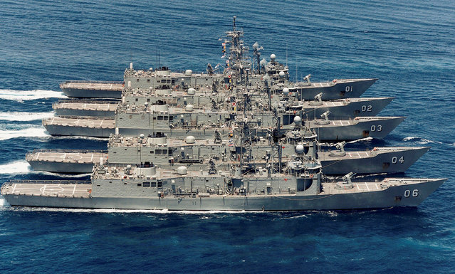An undated handout released on May 25, 2017 shows the Royal Australian Navy's Adelaide Class frigates (from top) HMAS Adelaide, HMAS Canberra, HMAS Sydney, HMAS Darwin and HMAS Newcastle sailing in formation near Darwin in Australia. (Photo by Reuters/Australian Defence Force)