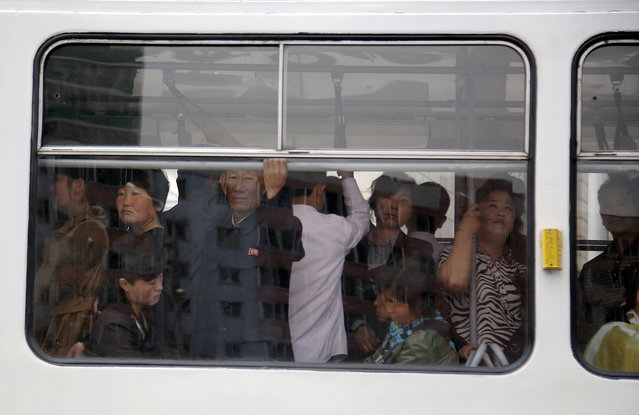 North Korean commuters ride on a city trolley bus, Saturday, May 9, 2015 in Pyongyang, North Korea. The city trolley is one of the more common forms of public transportation among North Koreans living in Pyongyang. (Photo by Wong Maye-E/AP Photo)