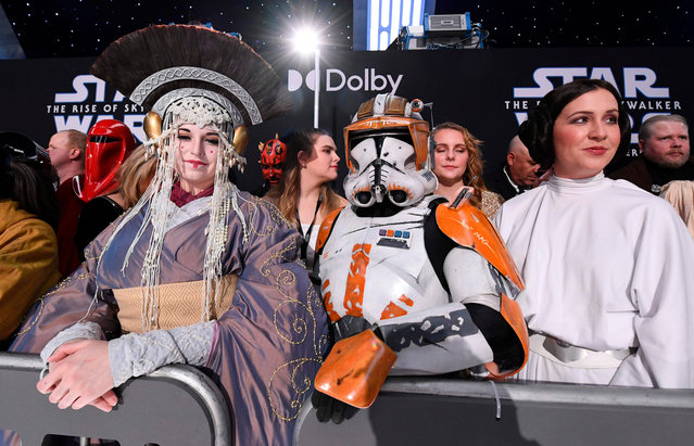 "Fans in Star Wars costumes attend the world premiere of Disney's ""Star Wars: Rise of Skywalker"" at the TCL Chinese Theatre in Hollywood, California on December 16, 2019. (Photo by Valerie Macon/AFP Photo)"