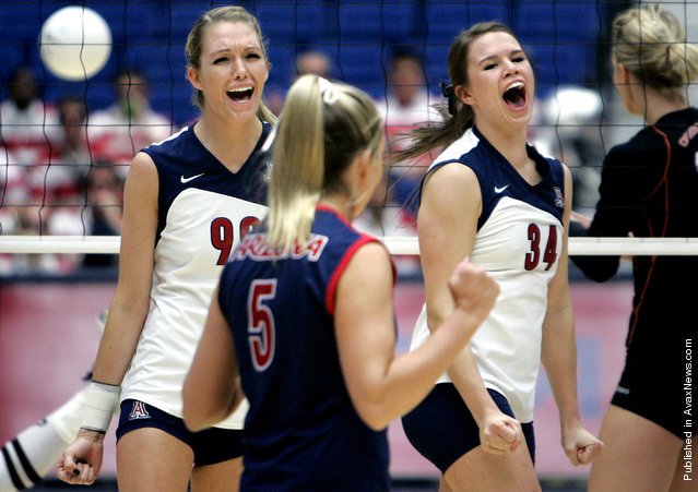Arizona's Brooke Buringrud, left, Brittany Leonard, and Paige Weber celebrate a point during the first game of their match against Oregon State on senior day at McKale Center Nov. 23, 2008 in Tucson, Ariz