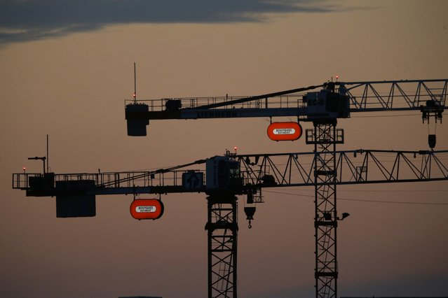 Two cranes with the French construction group Bouygues company logo are seen in the morning sky in Orly, France, near Paris, August 1, 2015. (Photo by Stephane Mahe/Reuters)