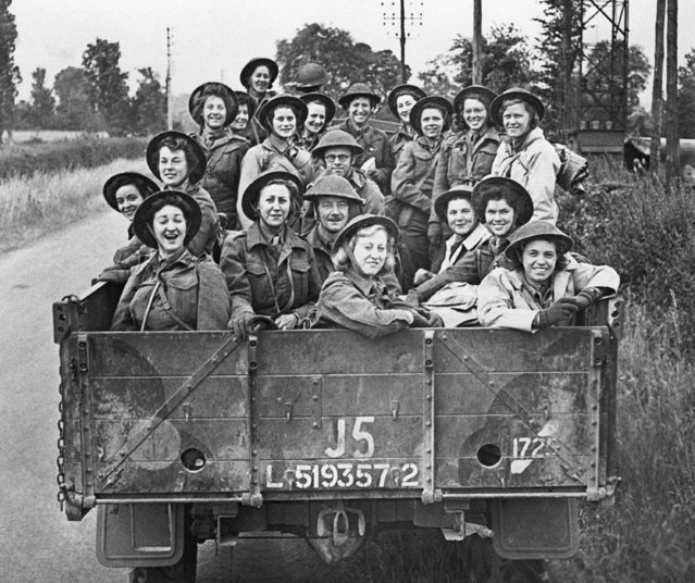 Members of Queen Alexandra's Imperial Military Nursing Service, the Nursing Service which is attached to the British Army, have arrived in France to assist in tending the wounded. A truck load of British Army nurses on their way to the Normandy front on June 23, 1944. (Photo by AP Photo)