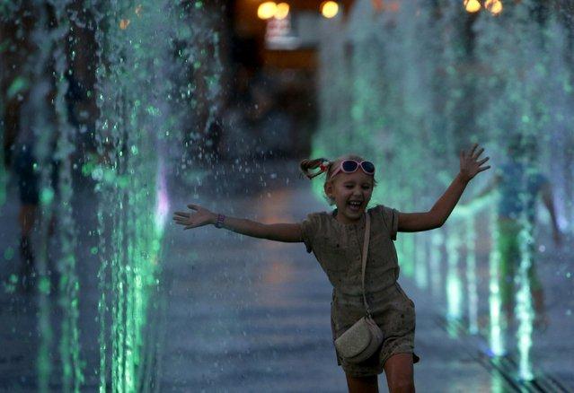 A girl runs through a fountain at Gorky park in Moscow, Russia, August 9, 2015. (Photo by Sergei Karpukhin/Reuters)