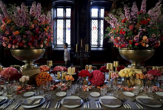 "A dining table is decorated with flowers at the ""Flowertime"" event in Brussels' town hall, Belgium, August 12, 2015. The event, which will open to visitors between August 13 and 16, 2015 has an Italian baroque theme this year. (Photo by Francois Lenoir/Reuters)"