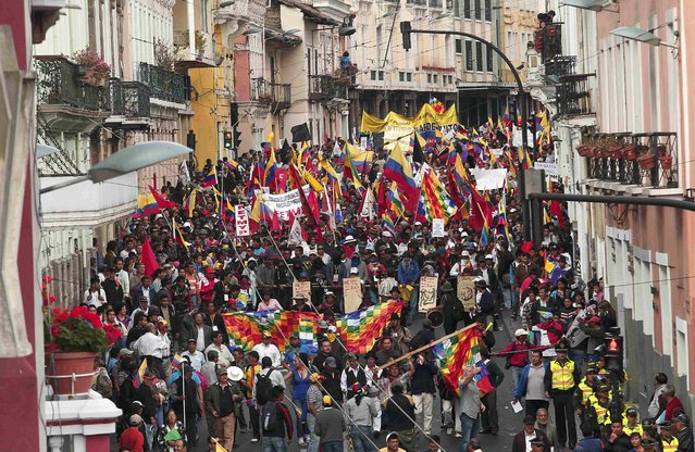 Demonstrators march in Quito, Ecuador, August 13, 2015. (Photo by Guillermo Granja/Reuters)