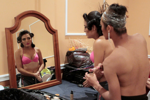 """Participants get ready backstage before the start of the """"Miss Gay Nicaragua 2016"""" beauty pageant in Managua, Nicaragua June 25, 2016. Picture taken June 25, 2016. (Photo by Oswaldo Rivas/Reuters)"""