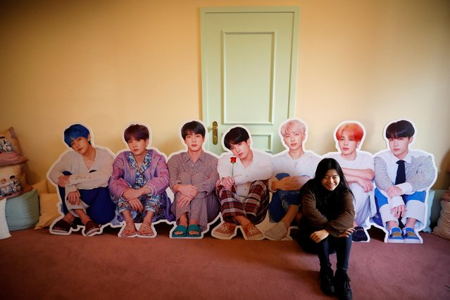 A fan of K-pop idol boy band BTS poses for photographs with cut-out of BTS at a pop-up store selling BTS goods in Seoul, South Korea, December 24, 2019. (Photo by Kim Hong-Ji/Reuters)