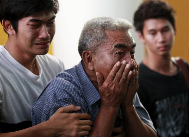 Relatives cry as they remove the body of Suwan Sudmun, a Thai victim of Monday's bomb blast, at the Institute of Forensic Medicine in Bangkok, Thailand, August 18, 2015. (Photo by Chaiwat Subprasom/Reuters)