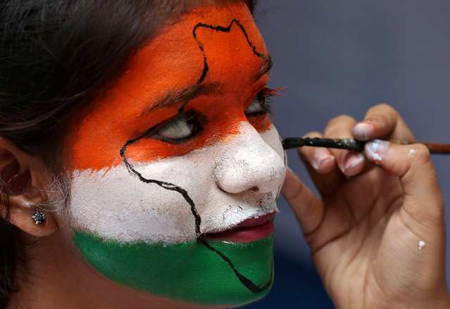 A girl gets her face painted in the colours of India's national flag, as she takes part in Independence Day celebrations inside a college in Chennai, August 15, 2017. (Photo by P. Ravikumar/Reuters)