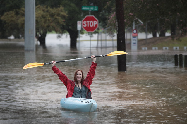 Ashley Ward kayaks down a flooded street that has been inundated with water from Hurricane Harvey on August 27, 2017 in Houston, Texas. Harvey, which made landfall north of Corpus Christi late Friday evening, is expected to dump upwards to 40 inches of rain in areas of Texas over the next couple of days. (Photo by Scott Olson/Getty Images)
