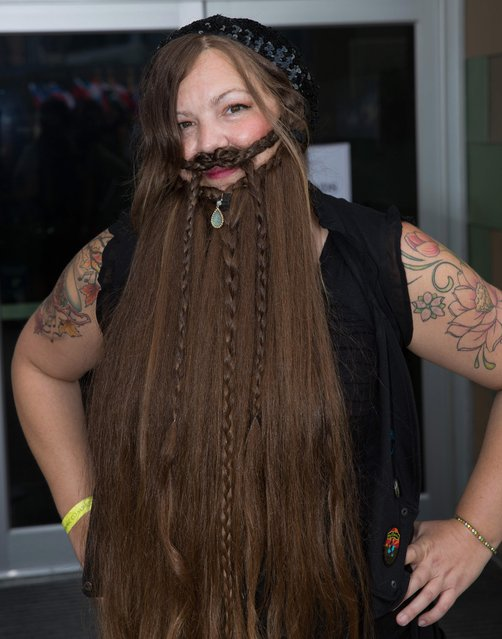An attendee at the 2017 Remington Beard Boss World Beard & Moustache Championships held at the Long Center for the Performing Arts on September 3, 2017 in Austin, Texas. (Photo by Suzanne Cordeiro/AFP Photo)