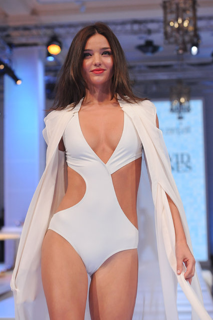 Miranda Kerr models several different outfits on the catwalk of the David Jones Spring/Summer collection launch at the David Jones store