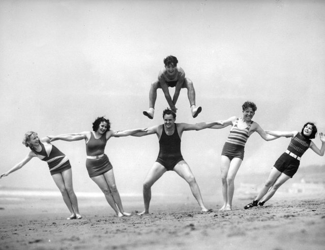 Leap-frogging on a Californian beach. 14th May 1930.