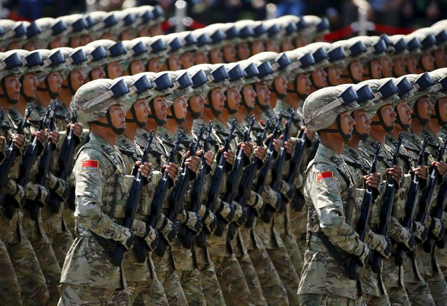 Soldiers of China's People's Liberation Army (PLA) march during the military parade marking the 70th anniversary of the end of World War Two, in Beijing, China, September 3, 2015. (Photo by Damir Sagolj/Reuters)