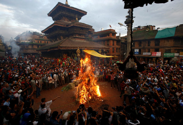 "People set fire to an effigy of the demon Ghantakarna, to symbolize the destruction of evil, during the Ghantakarna festival at the ancient city of Bhaktapur, Nepal August 1, 2016. According to local folklore, the demon Ghantakarna is believed to ""steal"" children and women from their homes and their neighbourhoods. (Photo by Navesh Chitrakar/Reuters)"