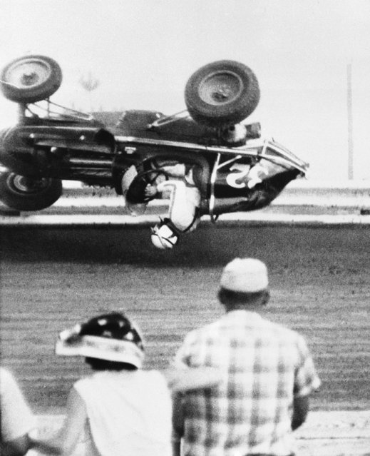 Jack Rounds, 23, Los Angeles, Calif., escaped serious injury when his sprint car crashed into the outside rail and rolled over in mid-air during the 2nd lap of the semi-feature event at the Terra Haute speedway on August 22, 1960. Rounds was taken to a local hospital and detained for observation. Cecil Beaver won the semi-feature race. (Photo by AP Photo)