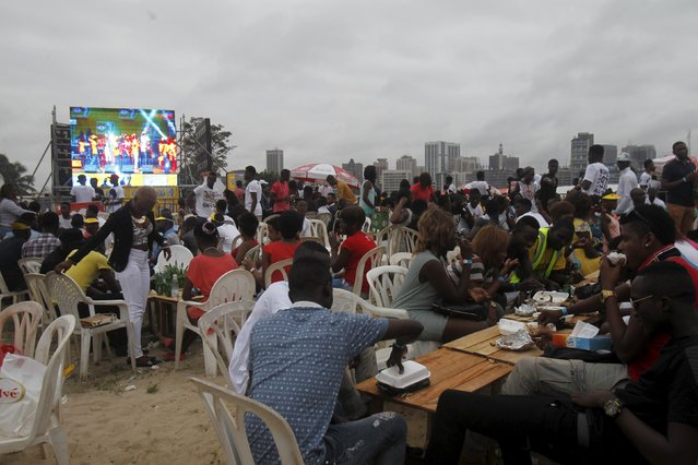 Attendees eat during the Festival des Grillades, in the yard of the Culture Palace of Abidjan, September 6, 2015. (Photo by Luc Gnago/Reuters)