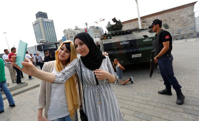Algerian tourists take a selfie in front of an abandoned tank, following a thwarted coup, at Taksim Square in Istanbul, Turkey, July 17, 2016. (Photo by Murad Sezer/Reuters)