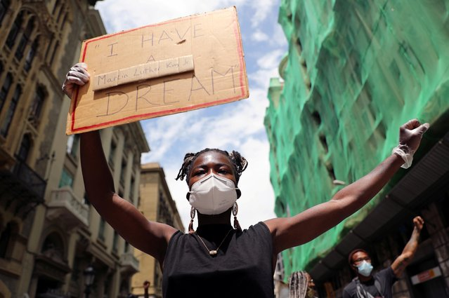 A demonstrator holds a placard during a protest against racial inequality in the aftermath of the death in Minneapolis police custody of George Floyd, in Barcelona, Spain on June 7, 2020. (Photo by Nacho Doce/Reuters)