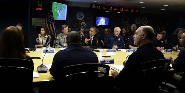 President Barack Obama speaks during a briefing at Federal Emergency Management Agency headquarters, with FEMA Administrator Craig Fugate, at right, in Washington on Sunday. FEMA is coordinating the deployment of federal resources in preparation for Hurricane Sandy's assault on the Northeast. (Photo by Jacquelyn Martin/Associated Press)