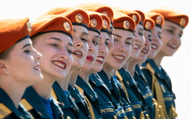 Female Ministry of Emergency Situations employees march during the Victory Day military parade marking the 75th anniversary of the Nazi defeat in WWII, at Dvortsovaya (Palace) Square in St.Petersburg, Russia, Wednesday, June 24, 2020. The Victory Day parade normally is held on May 9, the nation's most important secular holiday, but this year it was postponed due to the coronavirus pandemic. (Photo by Dmitri Lovetsky/AP Photo)