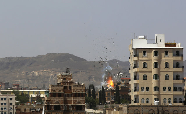 Debris and smoke rise after a Saudi-led airstrike hits an army base in Sanaa, Yemen, Monday, September 14, 2015. Saudi Arabia is leading a coalition of mainly Gulf nations fighting Shiite Yemeni rebels known as the Houthis, who are allied with army units loyal to former President Ali Abdullah Saleh. (Photo by Hani Mohammed/AP Photo)