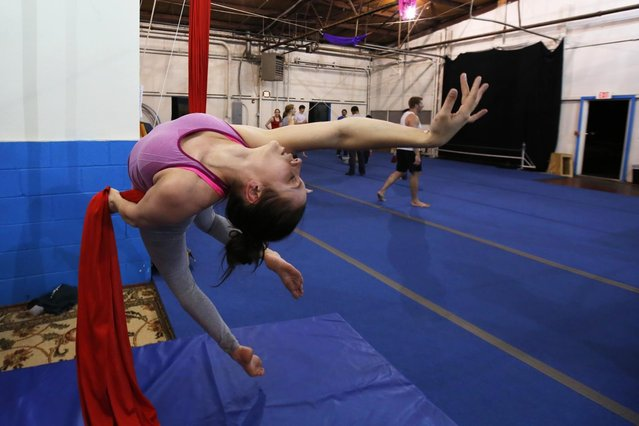 Nicole Londraville works on aerial silks at Esh Circus Arts, a circus school and training center offering recreational circus instruction, in Somerville, Massachusetts May 7, 2014. (Photo by Brian Snyder/Reuters)