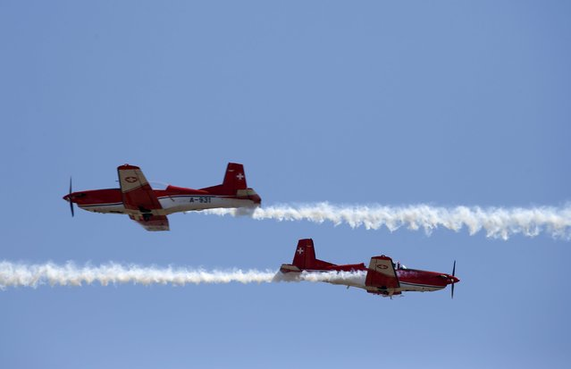 The Swiss Air Force PC-7 Team, flying Pilatus PC-7 Turbo Trainer aircraft, take part in a display during the Malta International Airshow at Malta International Airport, outside Valletta, Malta, September 27, 2015. (Photo by Darrin Zammit Lupi/Reuters)
