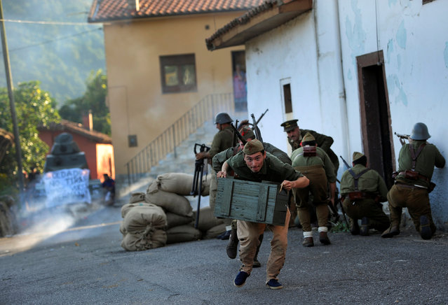 "Members of the association historical recreation Frente del Nalon participate in the recreation of the battle: ""The Siege of Oviedo"" that took place during the Spanish Civil War, in Grullos, near Oviedo, in northern Spain, September 3, 2016. (Photo by Eloy Alonso/Reuters)"