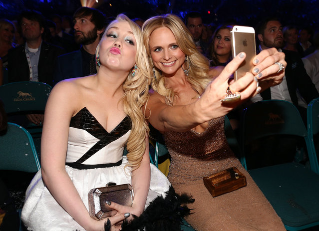 Recording artist RaeLynn (L) takes a selfie photo with recording artist Miranda Lambert during the 49th Annual Academy of Country Music Awards at the MGM Grand Garden Arena on April 6, 2014 in Las Vegas, Nevada. (Photo by Christopher Polk/ACMA2014/Getty Images for ACM)
